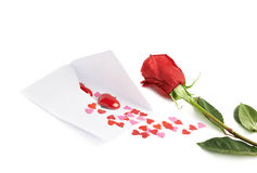 Rose and envelope filled with hearts Royalty Free Stock Photography