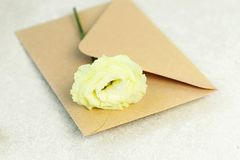 Rose and envelope on grey background stock images