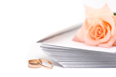 Rose, envelopes and wedding rings Stock Images