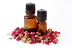 Rose Essential Oil. Essential oils with rose buds royalty free stock images