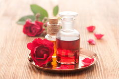 Rose essential oil and flowers roses. Royalty Free Stock Photos