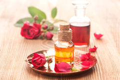 Rose essential oil and flowers roses Royalty Free Stock Photo