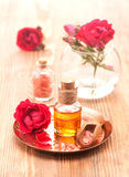 Rose essential oil, sea salt and rose flowers. Body Care and Spa Stock Photos