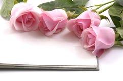 Rose et cahier Photo libre de droits