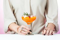 The rose exotic cocktails and fruits and female hand. The female hand and rose exotic cocktail and fruits on table Stock Photography