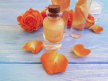 Rose extract on wooden background stock photos