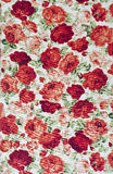 Rose on fabric as background