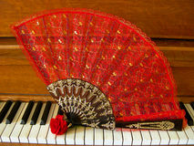 Rose Fan on Piano Stock Image