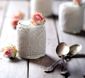 Rose flavor Greek yogurt in a glass jarwith lace Royalty Free Stock Photo