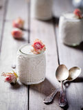 Rose flavor Greek yogurt in a glass jarwith lace Royalty Free Stock Photography