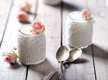 Rose flavor Greek yogurt in a glass jarwith lace Stock Photography
