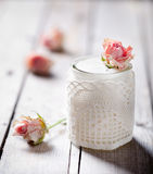 Rose flavor Greek yogurt in a glass jarwith lace Stock Photos
