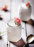 Rose flavor Greek yogurt in a glass jarwith lace Royalty Free Stock Photos
