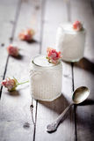 Rose flavor Greek yogurt in a glass jarwith lace Stock Image