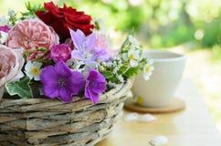 Rose flower arrangement with tea Stock Photography