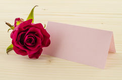 Rose flower with blank invitation card on wooden background Royalty Free Stock Image