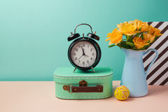 Rose flower bouquet and alarm clock still life. In Memphis style stock images