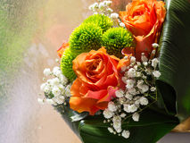 Rose flower bouquet. Detail of flower bouquet with orange roses Royalty Free Stock Photos