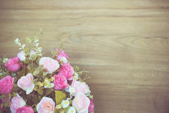 Rose flower bouquet on wooden backdrop Stock Photos