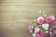 Rose flower bouquet on wooden backdrop Stock Images