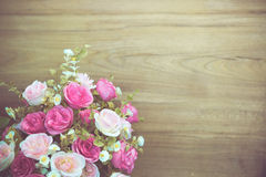 Rose flower bouquet on wooden backdrop Stock Image