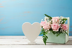 Rose flower bouquet in wooden box and heart shape sign stock image