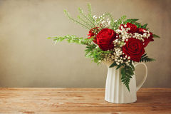 Rose flower bouquet on wooden table with copy space stock photo