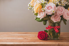 Rose flower bouquet on wooden table for Mother's Day celebration Stock Images