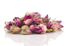 Rose dry tea. Rose flower dry tea isolated on a white background royalty free stock photography