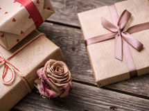 Rose flower among the gift boxes Royalty Free Stock Image
