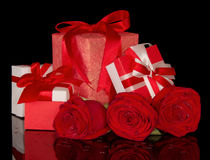 Rose flower and gift boxes isolated on black. Background. Red Valentine's Day Border Art Design Royalty Free Stock Photo