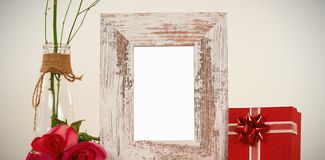 Rose flower in glass vase, photo frame and gift box. Rose flower in glass vase, empty photo frame and gift box royalty free stock photography