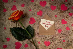 Rose flower, hearts and envelope with text Happy St. Valentine`s Royalty Free Stock Image
