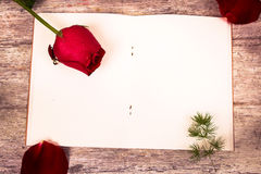 Rose flower on note book Royalty Free Stock Photography