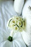 Rose flower wedding bouquet on bed Royalty Free Stock Images