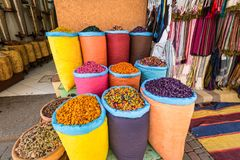 Rose flowers on a moroccan market, Marrakesh, Morocco. Marrakesh, Morocco - December 8, 2016: Piles of vibrant, colourful herbs and potpourri in bags at a market Royalty Free Stock Image