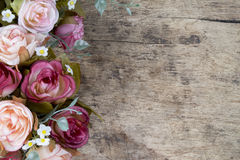 Rose flowers on rustic wooden background. Copy space. Stock Photo