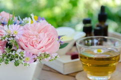 Rose flowers and tea for aromatherapy treatment Stock Photos