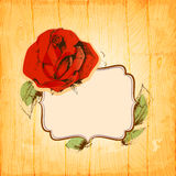 Rose frame. Over vintage wood texture background Royalty Free Stock Image