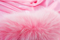 Rose fur on a rose textile. Colored rose fur of polar fox isolated on a rose textile Stock Images