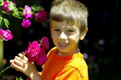 In The Rose Garden. Young Boy Outdoors In THe Rose Garden Royalty Free Stock Photos