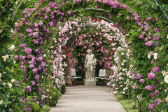 The rose garden Beutig in Baden-Baden. Rose arches and gods statue in the rose garden Beutig in Baden-Baden, Black Forest, Baden-Wurttemberg, Germany, Europe Stock Photos