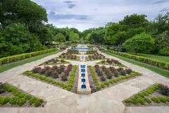 Rose Garden on a Cloudy Day. Beautifully landscaped urban rose garden on a cloudy spring day in Texas Royalty Free Stock Image
