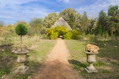 Rose garden with a hut. Rose garden in Fuveszkert in Szeged, Hungary, Aun stock image