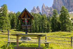 Rose garden mountains. Crucifix infront of the rose garden mountains, south tyrol, italy royalty free stock images