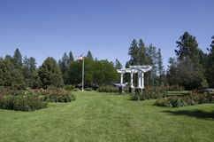Rose garden Spokane. Rose garden in traditional style with pavilion Royalty Free Stock Photography