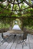 Rose garden. Wooden pergola and rose garden in the countryside Royalty Free Stock Photography