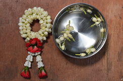 Rose garland and jasmine in silver bowl Stock Image