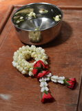 Rose garland and jasmine in silver bowl Stock Images