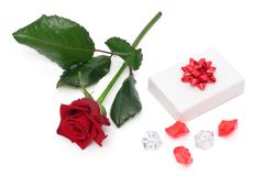 Rose and gift Stock Photography
